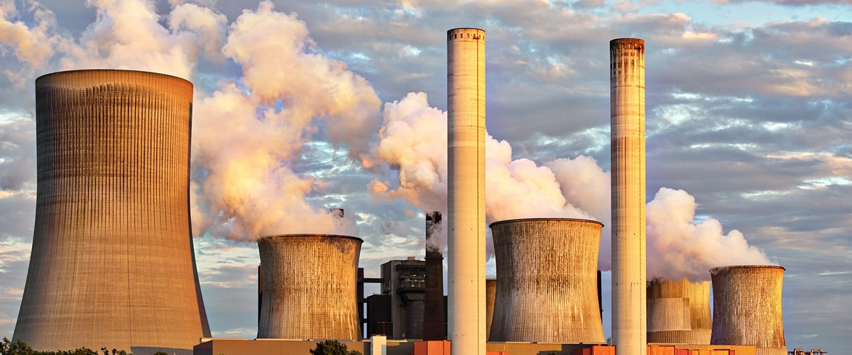 Picture of a power station with pollution coming out of the chimney